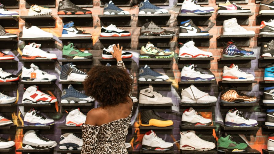 a woman shopping for a rubber shoes